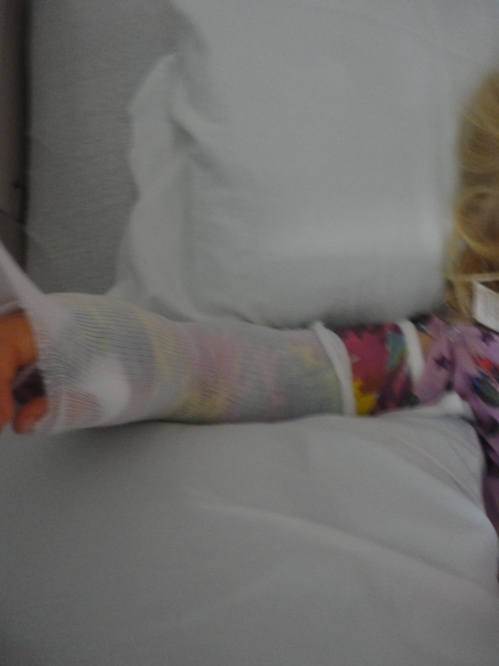 Tiny, little person in a giant hospital bed...with one bad-____ cast. Yes, it's rainbow hues. That's all.