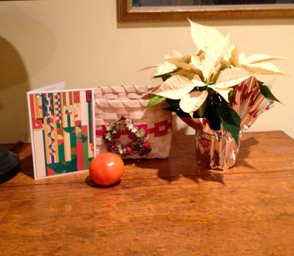 a basket, a card and a tangerine